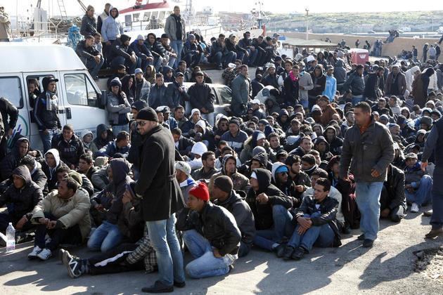 Immigrés tunisiens ( photo Reuters)
